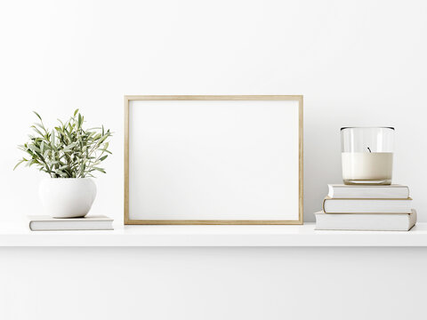 Horizontal wooden frame mockup with green olive twigs in vase and candle on white wall background. A4, A3, A size, 3d rendering, illustration