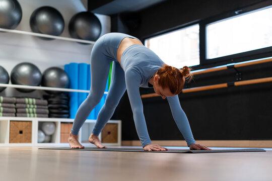 Woman doing Downward Facing Dog yoga pose