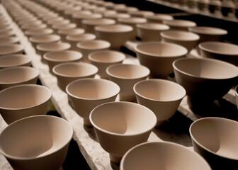 Obraz High angle shot of production line of ceramic cups - fototapety do salonu