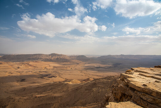 Ramon Crater Makhtesh Ramon, the largest in the world, as seen from the high rocky cliff edge surrounding it from the north, Ramon Nature reserve, Mitzpe Ramon, Negev desert, Israel. High quality