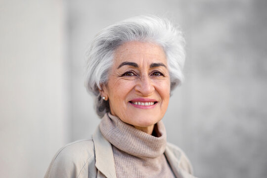 Woman with gray hair smiling