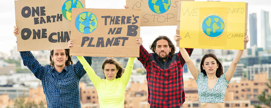 Men and women with banner protesting on climate change