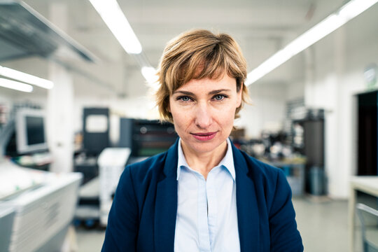 Female entrepreneur staring in workshop