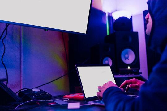 Young man hacking computer data at home