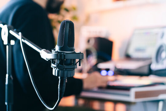 Condenser microphone on stand in studio