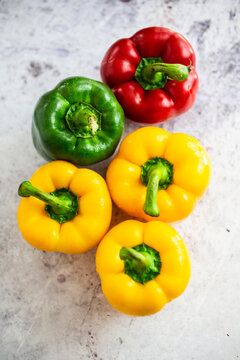 Studio shot of red, green and yellow bell peppers