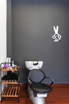 Armchair in front of black wall at barber shop