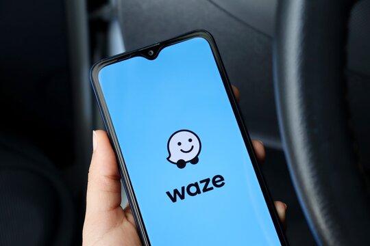Bahia, Brazil - April 30, 2021: Waze app on screen, inside a car. Waze is a navigation and live traffic app.