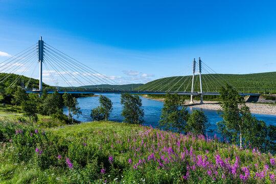 Sami Bridge stretching over Tana river in summer