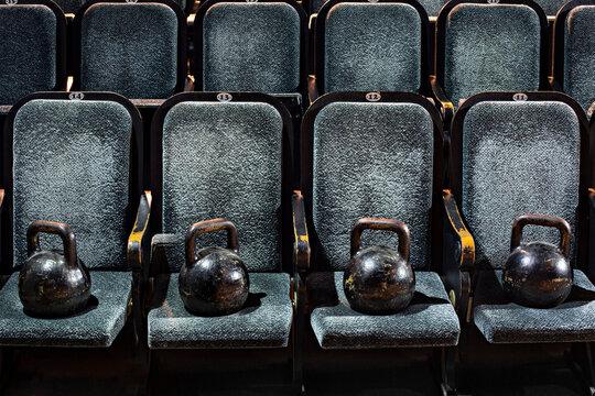 Kettlebells lying on seats in empty theater