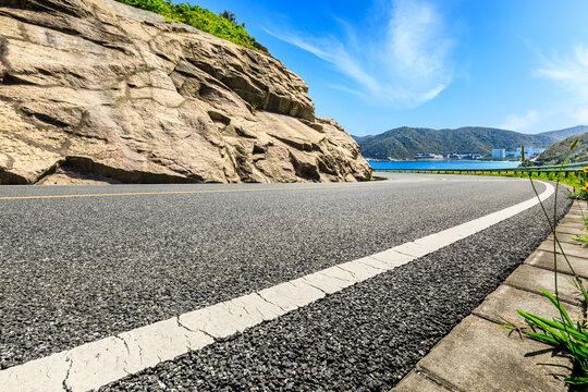 Empty asphalt road and mountain nature landscape.