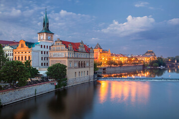 Prague Riverside. Cityscape image of Prague riverside with Old Town Water Tower at twilight blue hour.