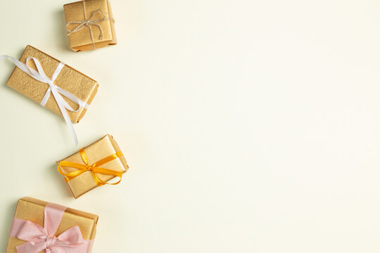 Gold gift boxes on yellow green background. flat lay, top view, copy space