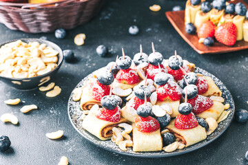 Fototapeta Breakfast pancake. A healthy breakfast with fruit. Pancake with fruit. Iced coffee and fruit. Dark background with pancakes and fruit. obraz