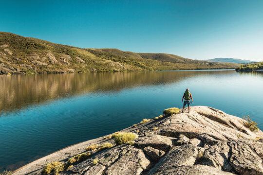 Man hiking near a beautiful lake