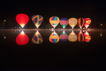 Glowing hot air balloons during the evening event of the first day of Balloon festival.