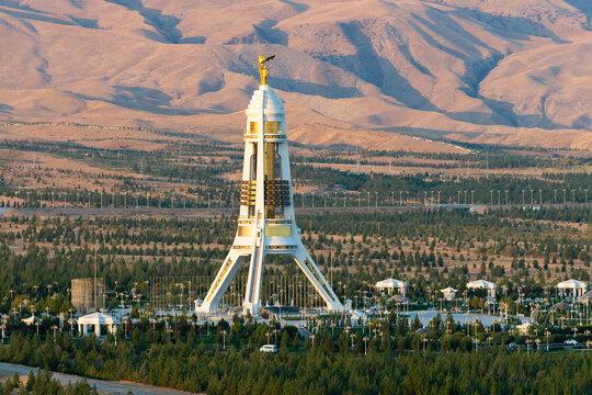 Neutrality Monument in Ashgabat, Turkmenistan built with white marble and gold details. Celebrate the country's neutrality in the United Nations.
