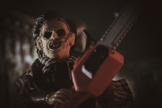 NEW YORK USA, JUNE 23 2021: Scene from Texas Chainsaw Massacre, killer Leatherface hunts victims with his chainsaw  - Mego Corp action figure