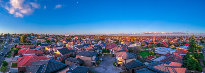Fototapeta Panoramic aerial Drone view of Melbournes suburbs and CBD looking down at Houses roads and Parks Victoria Australia obraz