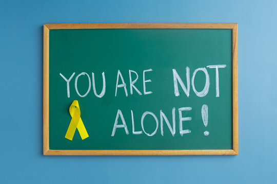 World Suicide prevention day ( 10 September), Yellow Ribbon for supporting people living and illness, Suicidal concept