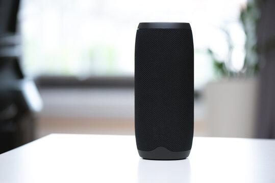 Smart speaker on table, intelligent assistant