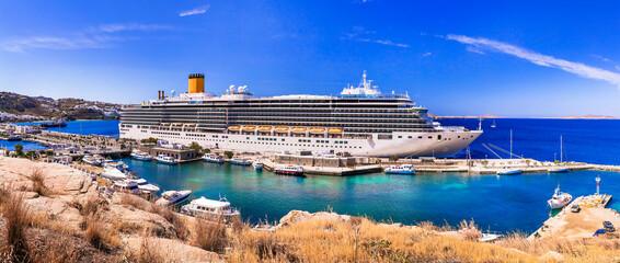 Cruise ship in port of Mykonos island. Greece travel. Mediterranean summer holidays