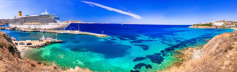 Mediterranean summer holidays. huge cruise ship in port of Mykonos island. Greece travel