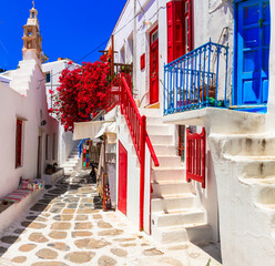 Authentic traditional Greece. Charming colorful floral streets of Mykonos island. Cyclades