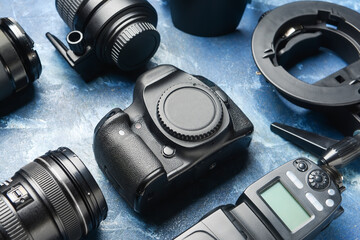 Modern photographer's equipment on color background, closeup