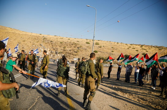 Palestinians protest as Jewish settlers march in West Bank