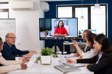 Obraz Manager woman sitting in front of camera talking on video call during virtual conference working Business people talking to webcam, do online conference participate internet brainstorming, distance - fototapety do salonu
