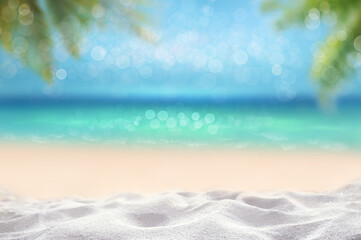 summer time tropical blurry seascape with sandy beach and wooden table top and blur palm leaves montage photo of Summer beach concept
