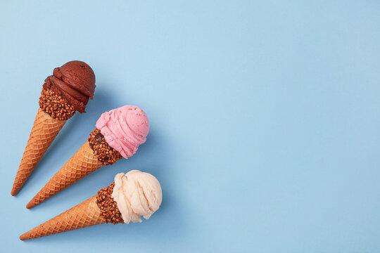 Strawberry, vanilla and chocolate ice cream cones