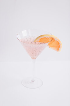 Refreshing martini cocktail with grapefruit on table