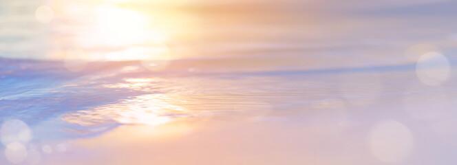 Abstract Bokeh sunset light background on peacful summer sea beach