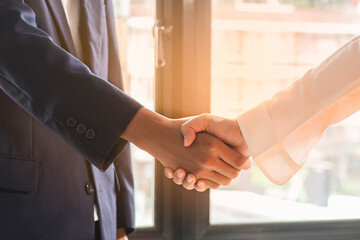 Fototapeta Successful asian young woman, man  partnership, team handshake or greeting together at office after project done, good deal. Happy business people, Worker meeting, shaking hands and success concept. obraz