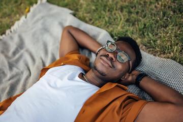 Fototapeta Adult man, taking an afternoon nap, outside. obraz