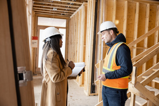 Homebuilders meeting at home construction site