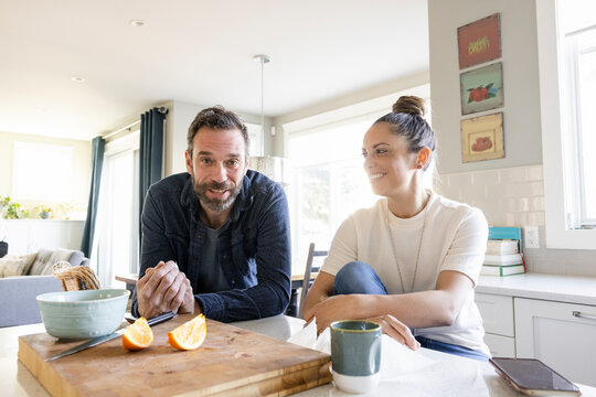 POV portrait couple enjoying breakfast and video chatting in kitchen