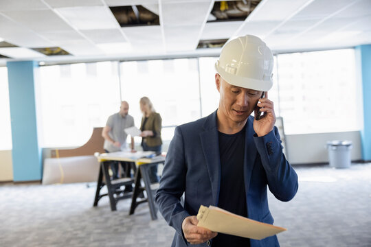 Architect on phone in empty office space