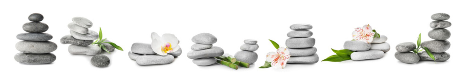 Spa stones with flowers on white background