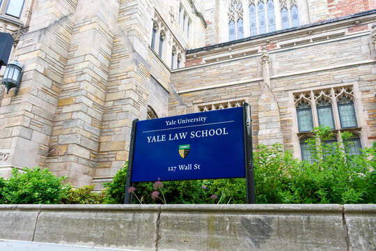 Yale University. Yale Law School sign and coat of arms at Sterling Law Building. - New Haven, Connecticut, USA - 2021