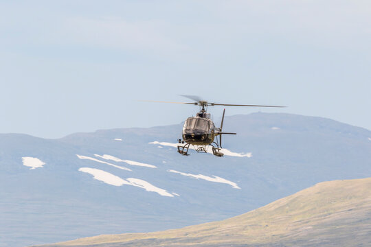 Helicopter In The Sky In A Mountain Landscape