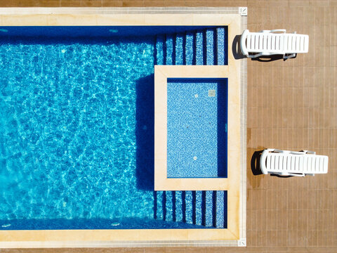 Sunbeds Near The Swimming Pool Top Down View.