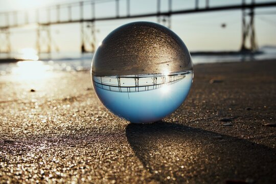 Close-up Of Crystal Ball On Beach