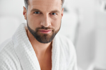 Fototapeta Positive man with styish waits for beauty procedures in cosmetologycal clinic obraz