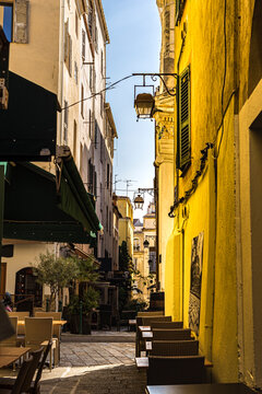 Typical old street with restaurants in the middle of Corsican Ajaccio city. France 2021