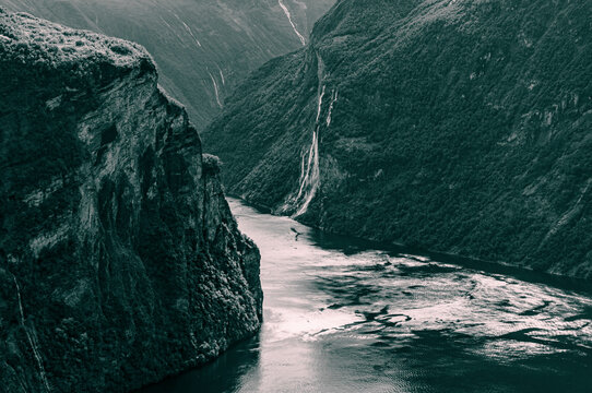 Monochrome Picture Of Geirangerfjord And The Waterfall Called Seven Sisters.