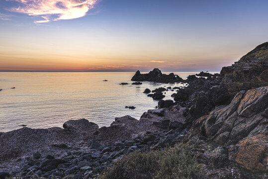 Rocky coastline at the famous Sanguinaires islands near corsican Ajaccio city under beautiful sunset light.