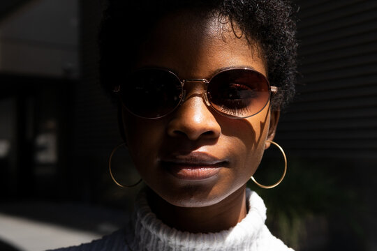 Trendy black female looking at camera